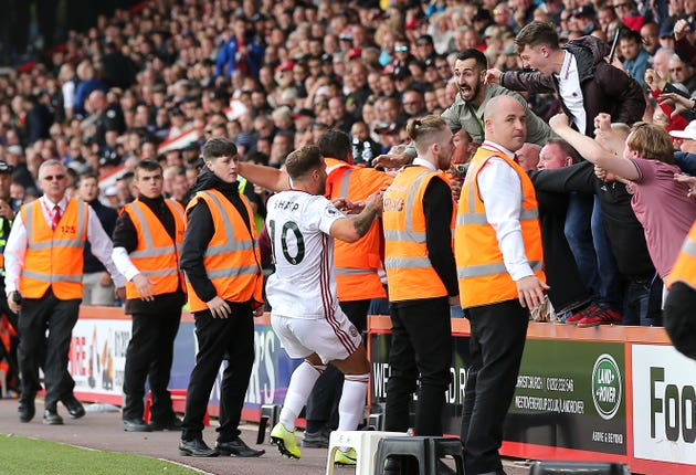 Billy Sharp celebrates with the Sheffield United fans after scoring a late equaliser at Bournemouth