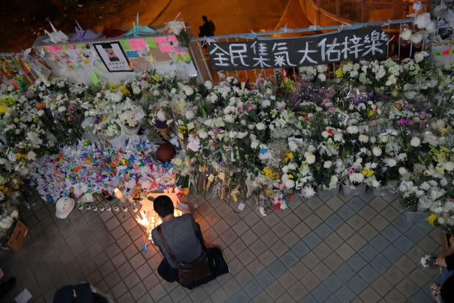 A protester light candles