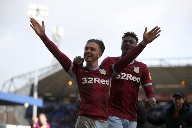 Aston Villa's Jack Grealish, left, and Tammy Abraham