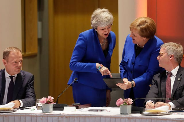 Theresa May and German Chancellor Angela Merkel share a smile