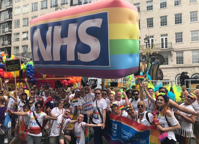 Guy's and St Thomas' NHS Foundation Trust  staff members celebrating the NHS rainbow badge scheme developed by Evelina London Children's Hospital, during the Pride in London Parade