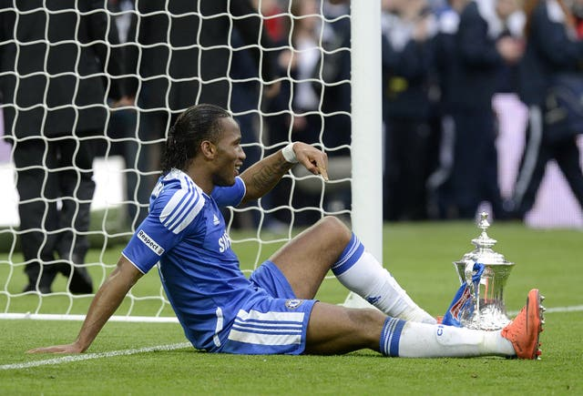 Didier Drogba, who scored Chelsea's second goal in their 2-1 win against Liverpool in the 2012 final, has a rest during post-match celebrations