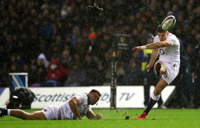Genge had to hold the ball for Farrell's kicks in treacherous Murrayfield conditions