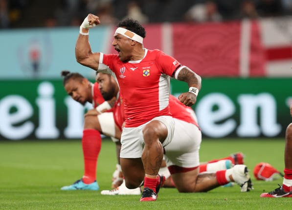 Tonga players perform the Sipi Tau ahead of the match with England