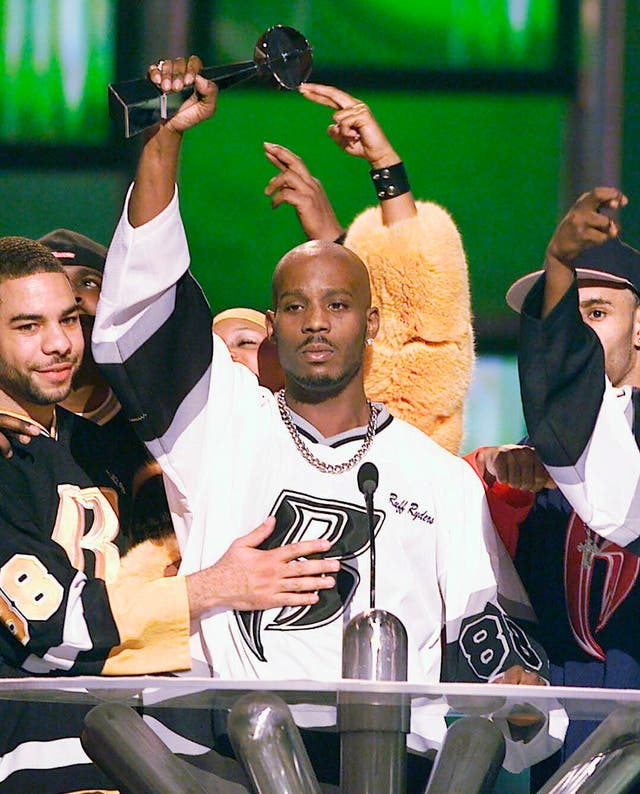 DMX, centre, accepts the R&B Album Artist of the Year during the 1999 Billboard Music Awards in Las Vegas