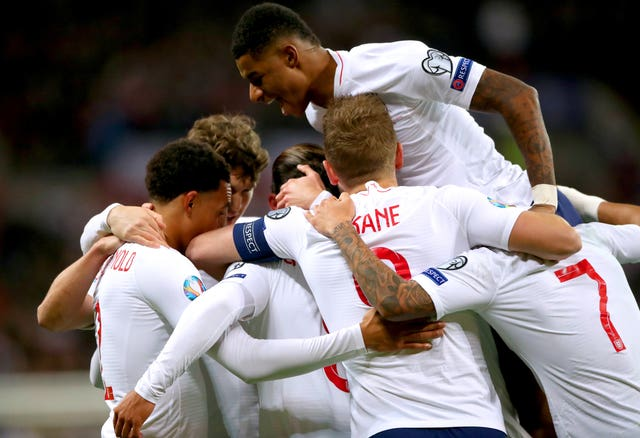 England players celebrate as team-mate Alex Oxlade-Chamberlain scores their opening goal