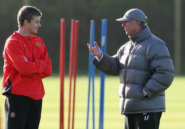 Sir Alex Ferguson talks with Solskjaer during a training session at Carrington