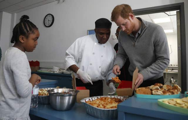 Prince Harry helped serve up pasta during the visit to the centre