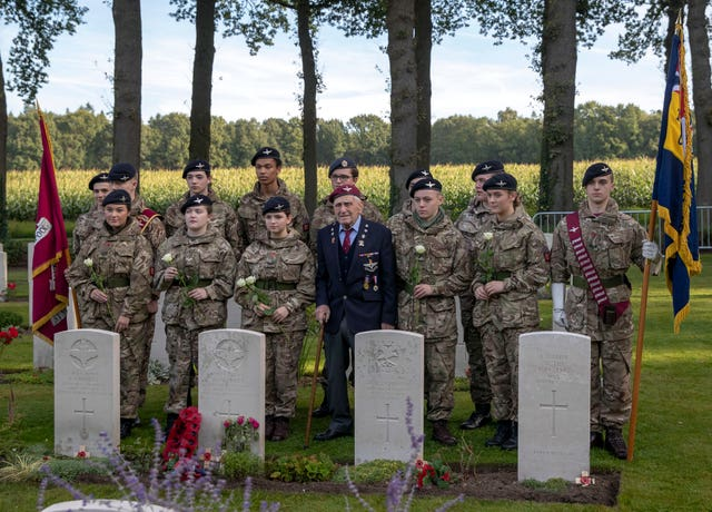 Veteran lays wreath at grave