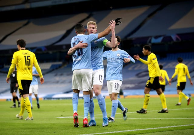 Kevin De Bruyne and Riyad Mahrez celebrate