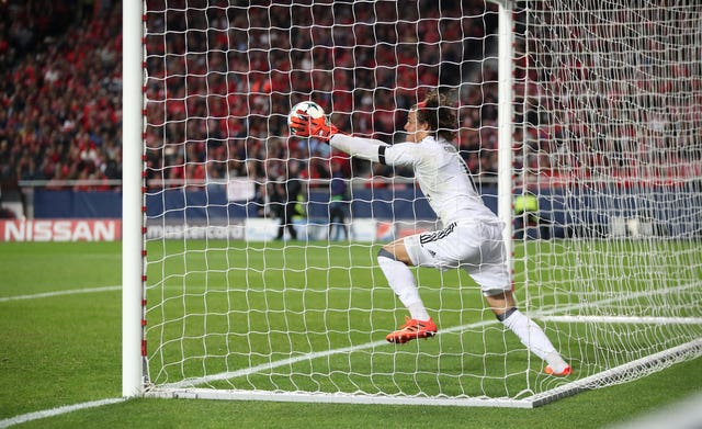 Benfica goalkeeper Mile Svilar concedes a goal in the Champions League against Manchester United