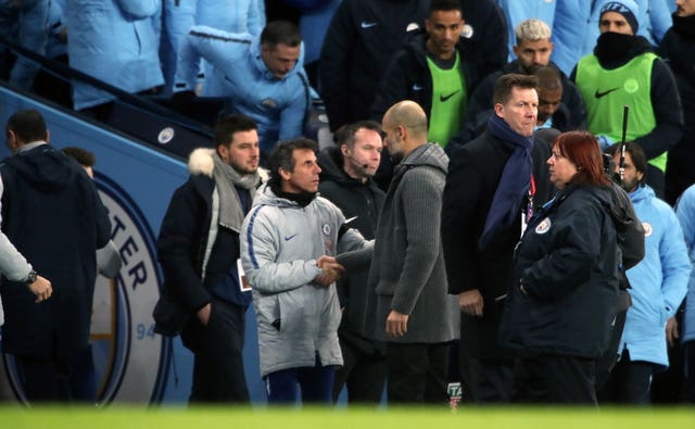 Pep Guardiola shakes hands with Chelsea assistant Gianfranco Zola as Chelsea manager Maurizio Sarri walks down the tunnel
