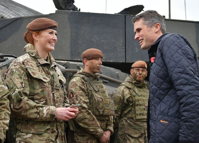 Defence Secretary Gavin Williamson speaking to Royal Wessex Yeomanry Tank Gunner reservist Lance Corporal Kat Dixon