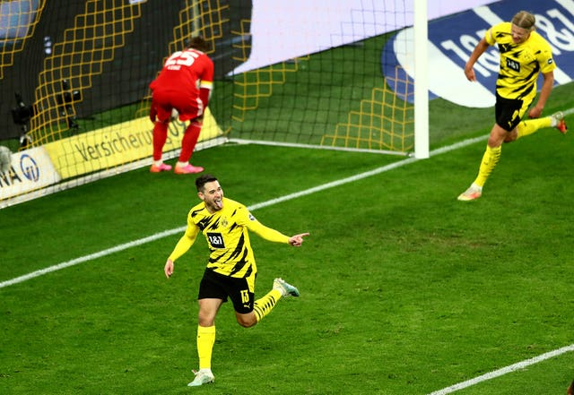 Raphael Guerreiro celebrates scoring for Dortmund