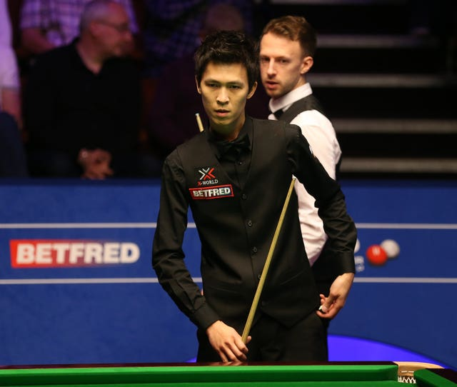 Thepchaiya Un-Nooh, foreground, and Judd Trump