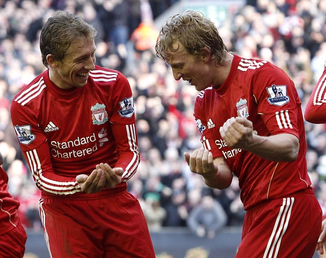 Liverpool's Dirk Kuyt (right) celebrates completing his hat-trick with team-mate Lucas Leiva
