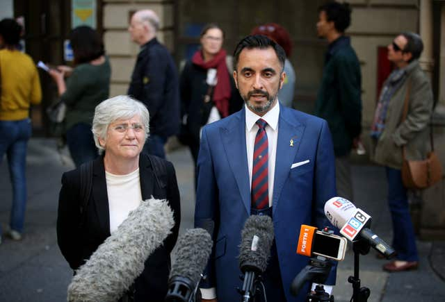 Clara Ponsati and her lawyer Aamer Anwar outside Edinburgh Sheriff Court before her preliminary hearing (Jane Barlow/PA)