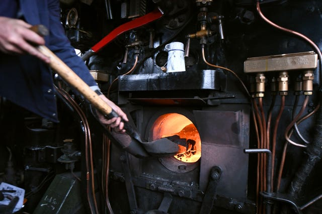Coal in a steam locomotive (Joe Giddens/PA)