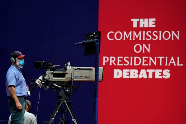 A camera operator waits for a rehearsal ahead of the first presidential debate between Republican candidate President Donald Trump and Democratic candidate Joe Biden in Cleveland