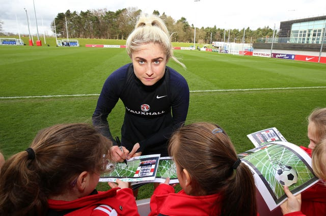 Houghton signs autographs during a training session at St George's Park (Nigel French/PA).
