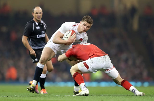 England captain Owen Farrell (left) in action during the Six Nations defeat away to Wales.