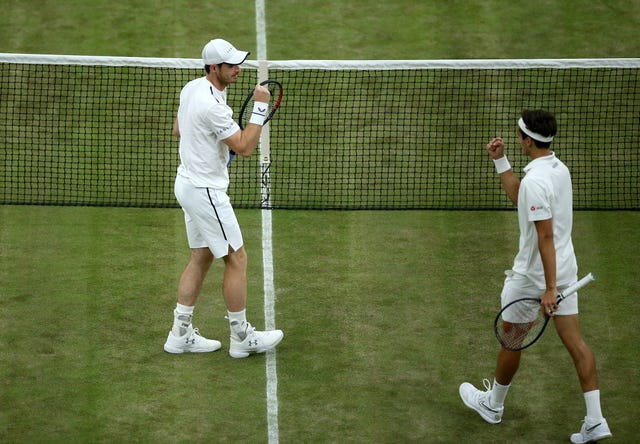 Pierre-Hugues Herbert and Andy Murray celebrate winning the match