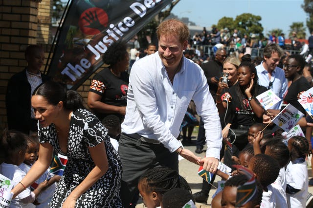 The Duke and Duchess of Sussex greeting children