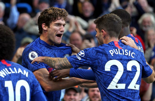 Marcos Alonso (left) celebrates with Christian Pulisic