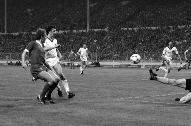 Kenny Dalglish chips the ball over Brugge goalkeeper Birigir Jensen