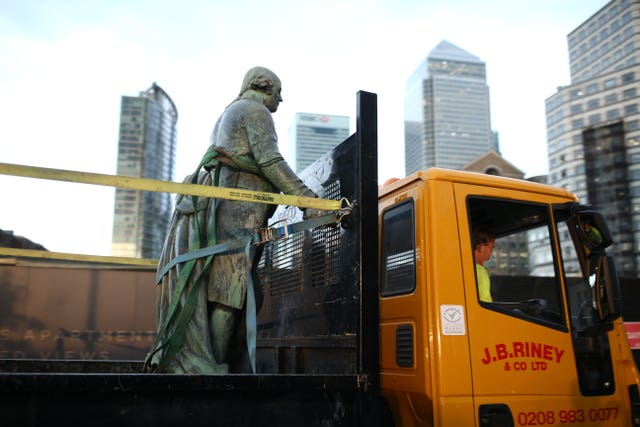 The statue is removed at West India Quay