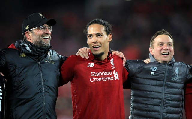 Virgil Van Dijk celebrated with Jurgen Klopp on the pitch at Anfield