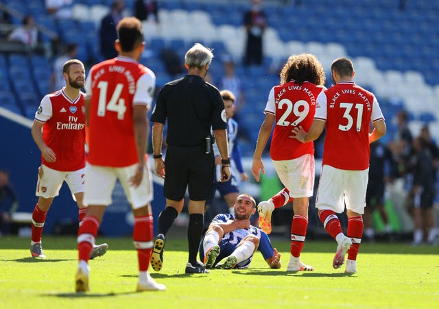 Brighton striker Neal Maupay clutches his neck after falling to the ground following an altercation with fellow Frenchman Matteo Guendouzi. The compatriots clashed during Albion's last-gasp 2-1 win over Arsenal on the first weekend after football resumed. Gunners midfielder Guendouzi has not appeared for the club since