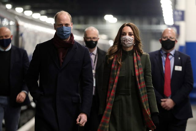 William and Kate walk along the platform before boarding the royal train. Chris Jackson/PA Wire