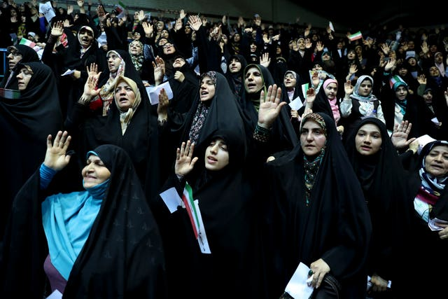 Veiled Iranian women attend a ceremony in support of the observance of the Islamic dress code for women, in Tehran