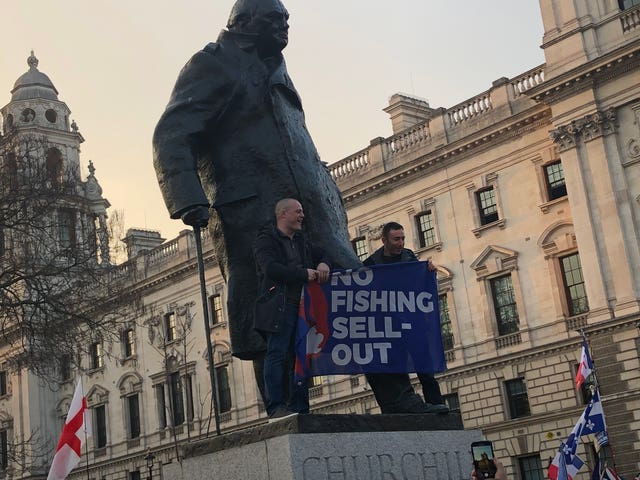 Brexit protesters climb on the statue of Winston Churchill in Parliament Square