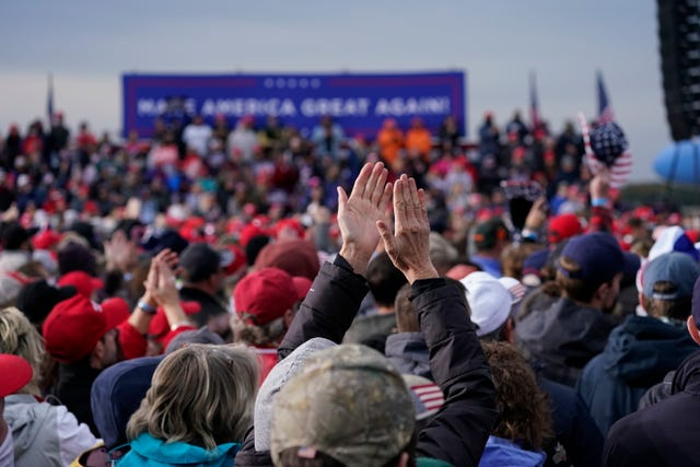 Supporters cheer Donald Trump as he speaks during the campaign rally at Muskegon County Airport