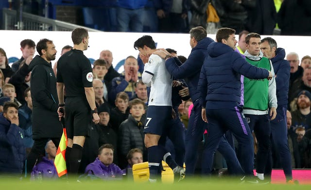 Son Heung-min is sent off for a challenge on Everton's Andre Gomes
