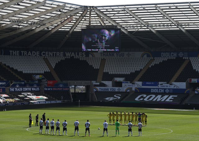 In Wales, Swansea and Wycombe players stood for a minute's silence