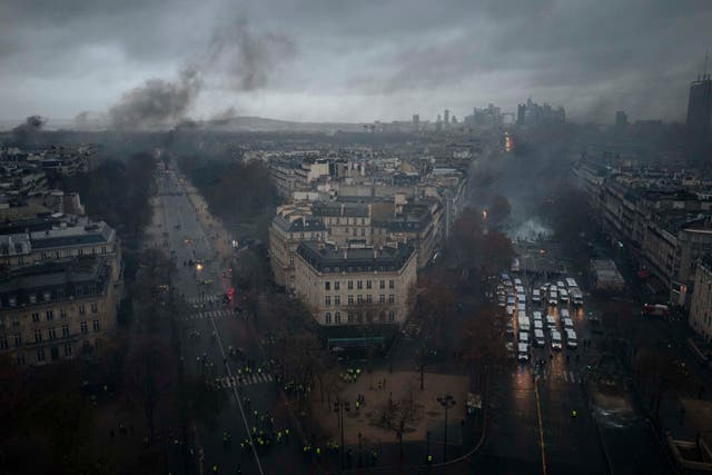 Smoke rises from avenues leading to the Arc de Triomphe