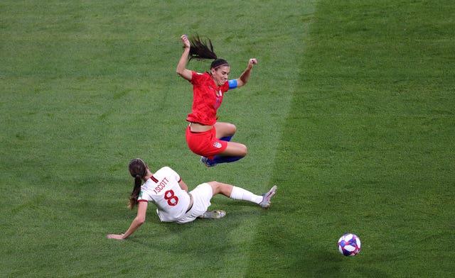 England's Jill Scott challenges Alex Morgan