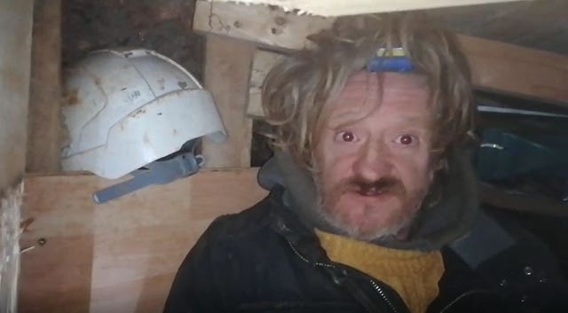 A protester known as Digger Down in part of a 100ft tunnel network dug in secret under Euston Square Gardens in central London, which they claim is at risk from the HS2 line development