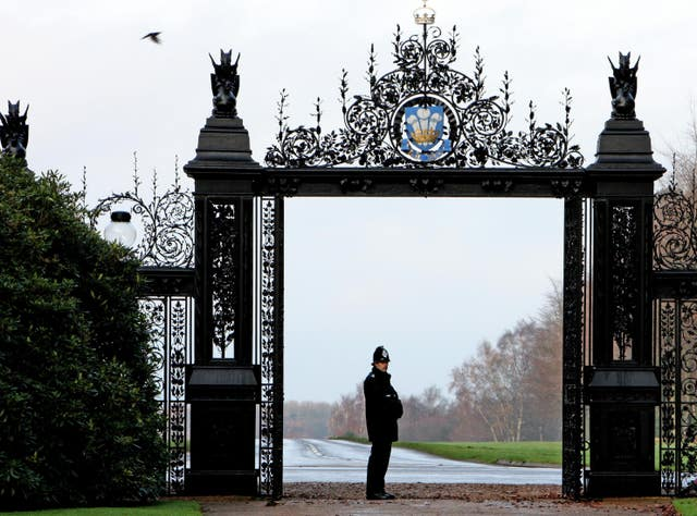 A police officer stands at the gates to Sandringham House (Chris Radburn/PA)