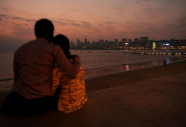 A couple watch the sunset