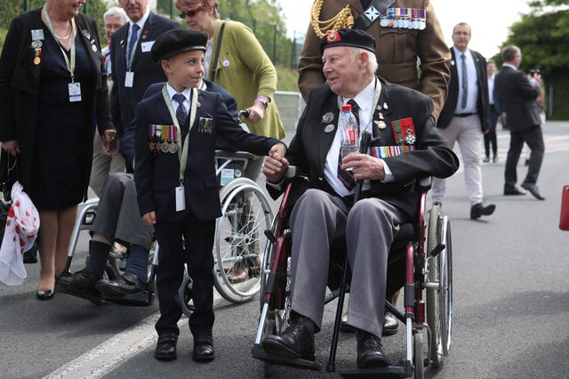 D-Day veteran John Quinn meets George Sayer, six, in Bayeu