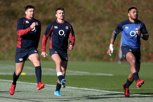 England's Henry Slade, centre, and Manu Tuilagi have a strong bond on and off the pitch