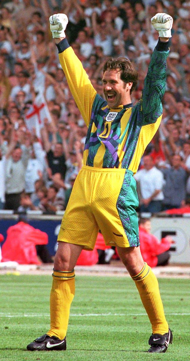 David Seaman celebrates saving a penalty from Scotland's Gary McAllister at Euro 96