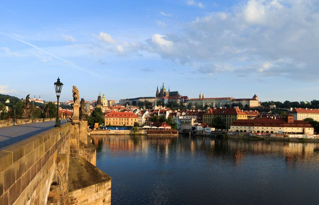 Prague castle seen from Charles bridge (John Walton/PA)