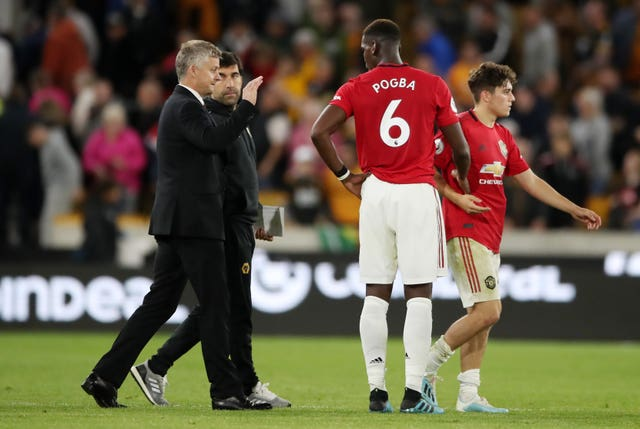 Solskjaer (left) insists he is happy with the players making the decision