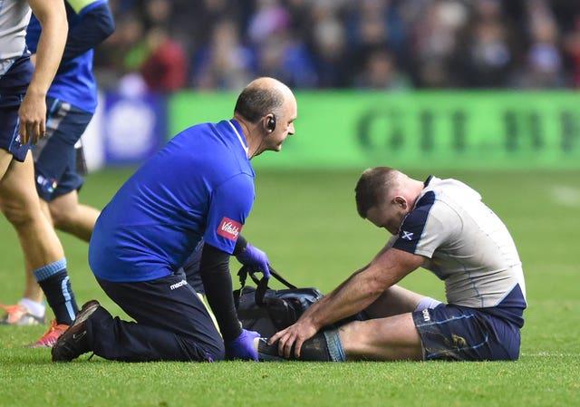Stuart Hogg of Scotland gets treatment from Scotland team doctor Dr James Robson