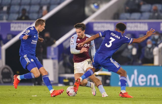 Aston Villa's Jack Grealish battles for the ball with Leicester's Timothy Castagne and Wesley Fofana